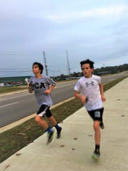 Carson Roberson, left, and Benjamin Allen, run a hill workout at Prattville Christian on Tuesday, Nov. 7, 2017. The two seventh graders are part of their school's first-ever boys AHSAA state qualifying team.