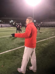 Pleasant head football coach Aaron Cook watches his