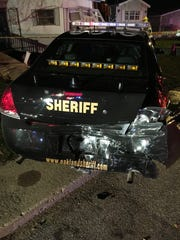 An Oakland County Sheriff's squad car shows damage