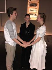 The Stage Manager (Leslie Miller, center) marries George Gibbs (Jack Barshaw) and Emily Webb (Sydney TImner).