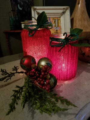 Place these sock-covered tea lights where you want them, add a tea light and dress it out with some greenery and ornaments.These would look good in a rustic setting or even on an outdoor patio table.