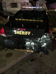 An Oakland County Sheriff's Office patrol car was damaged in an accident in Highland Township.
