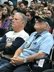 World War II veteran Charles Noll (right) enjoys the assembly with his son, Dennis.