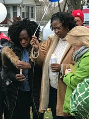 Brenda Hines (right in tan coat) serves as a Salvation Army chaplain.