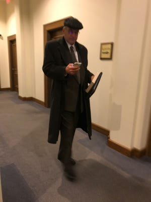 Charles Szyman exits the courtroom after the third day of his trial, Nov. 15, 2017.