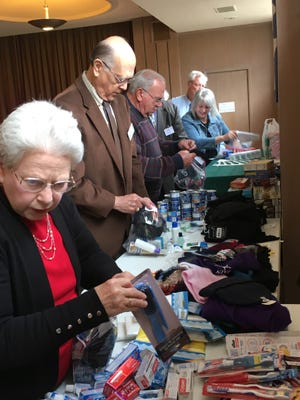 Members of Fain Presbyterian Church and New Covenant Presbyterian Church USA work together to fill hygiene kits that provide relief to disaster areas like the recent catastrophic flooding in Houston. On Nov. 19, members of Fain and New Covenant (the remnant congregation of First Presbyterian Church) will officially merge to become New Hope Presbyterian Church USA.