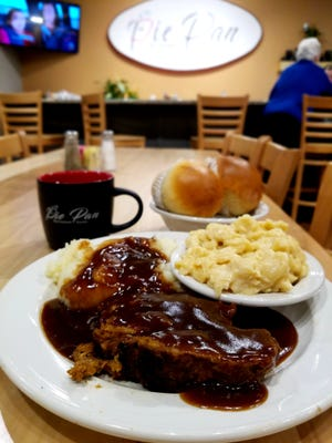Cold? A warm plate of the Pie Pan's meatloaf with mashed potatoes and one of the huge house rolls will warm you right up.