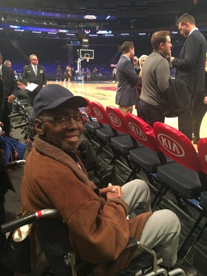 Robert Allen, JFK Haven Hospice patient, sitting courtside during the warm-ups before the game.