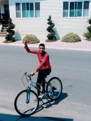 Gabriel Ruiz, 16, takes a spin around his new neighborhood