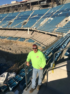 Steve Murray stands inside the Silverdome. The East China Township man has been hired to handle the explosives during Sunday's partial implosion.