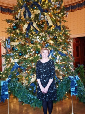 Marsha Gray, a Howell resident, stands in front of the official White House Christmas tree in the Blue Room on Nov. 27, 2017.