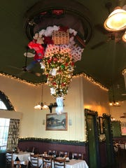 No, this picture isn't upside down. The D & R Depot in LeRoy decorates for the season with an upside-down Christmas tree.