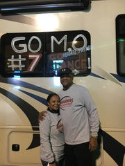 Pamela and Jeffrey Johnson drove their RV to cheer