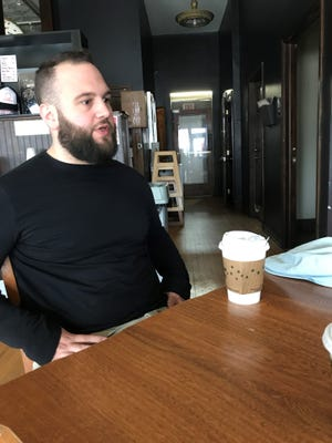 Cranky Al's manager co-owner Joey Carioti enjoying a cup of coffee in a file photo. Carioti faced some backlash after Gov. Scott Walker started his Election Day at the restaurant.