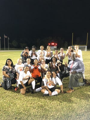 Cocoa High's girls soccer team celebrates its first win in years last Thursday night. Courtesy of Danielle O'Reilly.
