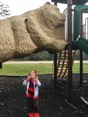 Avery Guidry, 3, does her best bear impression under a slide that looks like a bear at Palmetto Island State Park in Abbeville. Her favorite part at each state park has been the slides.