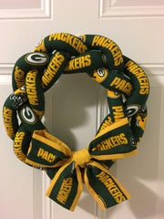 A fiberfill wreath complete with a Packers pattern
