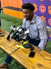 Clemson quarterback Kelly Bryant talks to the media