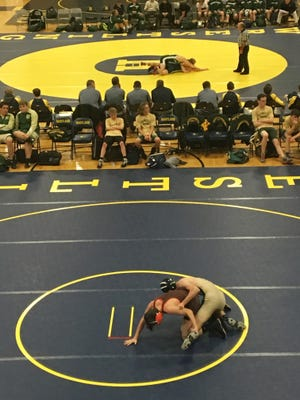 Hartland and Howell opened their wrestling seasons Wednesday in a quadrangular that included Flushing and Lake Orion.