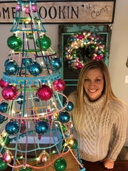 Robyn Graham's Christmas tree for the annual Visalia Chamber of Commerce Christmas Tree Auction will benefit Ruth Woods Open Arms House.