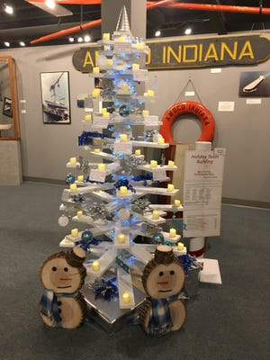 Tree donated by PortSide workers and subcontractors made for the Merry-Time Festival of Trees at Sturgeon Bay's Maritime Museum. The wooden tree features remote controlled lights and more than $1,500 in gift certificates  and merchandise.