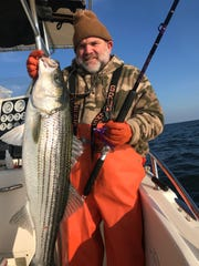 Dave Flood of Mantua with a nice striper that hit a big white Mojo on Dec. 4 on board the Hi Flier charter boat.