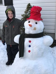 Tanya Banks snapped this photo with Eli Banks and his snowman in Swannanoa.