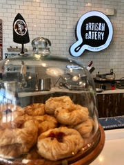 Fresh, house-baked pastries line the counters at Artisan Eatery.