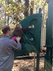 Avery Guidry, 3, climbs the playground at Tickfaw State Park in Springfield with help from dad Eric.