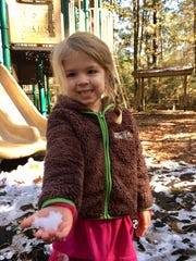 Avery Guidry, 3, plays with snow at Tickfaw State Park