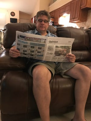 Scott Ross reads his favorite section of the Democrat.