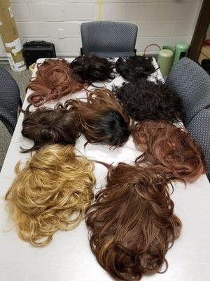Wigs allegedly used by a member of the Felony Lane Gang and seized by police in Mahwah, N.J.