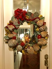 Kristin Paulson of Naples created a Christmas wreath made with fallen coconuts.