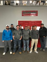 The West Shore Group team proudly wears Red Kettle pins in support of this year's Red Kettle Campaign. Pictured are, back row, from left: Chris Opsal, Chad Mongin, Debbie Hurley, Cindy Zellmer and Spencer Foth; front row: Matt Williams, Zach LePoidevin, Eugene Cudnohoski and Bill Mongin.