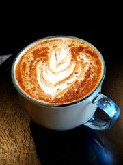 The Dante's Inferno latte begins with organic cinnamon