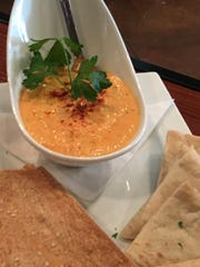 This Romesco Gouda Dip from Cellar + Plate is a perfect addition to your holiday table. This appetizer is warm and delicious. Call ahead and order a couple to take to a party or serve your family.