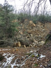 Rock, dirt and debris block N.C. 28 east of Fontana Village Resort in Graham County.