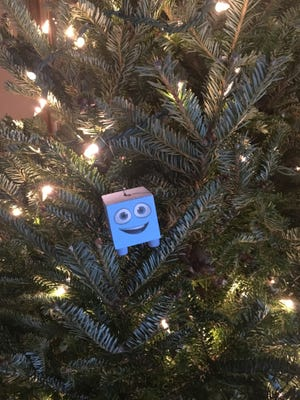 'Otto the ottoman' started as a Facebook joke, but became the Jenkins family mascot, complete with commemorative Christmas ornaments.