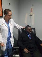 Adrian Gunn receives an IV treatment inside H2O Health