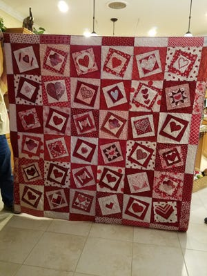 "Members of the Port St. Lucie Crazy Quilters created this Go Red for Women Heart Quilt. This quilt and two others will be auctioned at the ""Quilting in Paradise"" show in February."