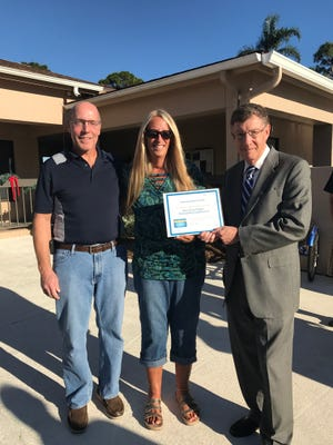 Dennis and Barbara Reffler, of Landmark Naples, a 55-plus community in North Naples, display Blue Zones Project recognition with Dr. Allen Weiss, president and chief executive officer of the NCH Healthcare System.