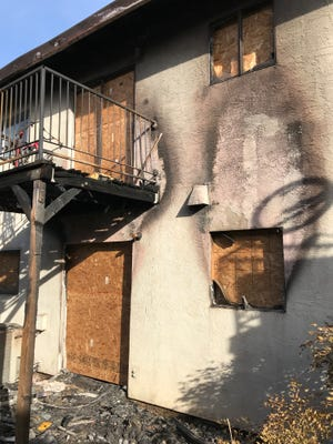 Fire damaged upstairs and downstairs apartments in a Friday night fire off Churn Creek Road.