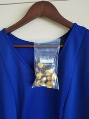 When traveling for business or pleasure, Heather McIntyre of Travel Experts Inc. in Raleigh, North Carolina, carefully plans each of her outfits in advance. In order to coordinate her clothing and accessories, as well as to keep her jewelry from becoming a tangled mess, she devised a simple solution whereby she cuts both sides of a Ziploc baggie under the closure, making it easy to hang the bag on a hotel hanger.