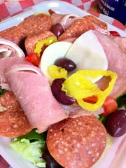 The antipasto at Slices was substantial, with fairly thick slices of rolled ham and the usual salad mix.