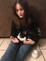 Gabriella Probst, 12, feeds her bunny a piece of ice from a jar she saved of Tallahassee's Jan. 3 snowfall.