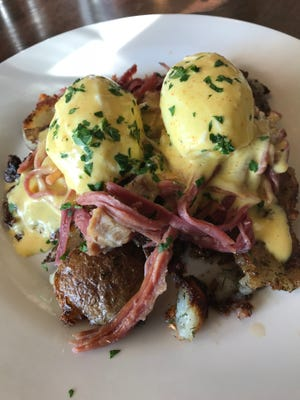 Eggs Benedict with corned beef (that's slow cooked for two days) over smashed potatoes at Spork Cafe & Catering in Suamico.