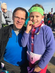 Greg Borowski and his daughter, Annaliese, after the Girls on the Run 5K in December at Miller Park.