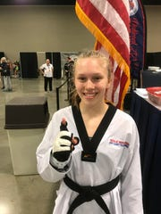 Natalie Hershberger, 13, is all smiles after earning a spot on the AAU National Taekwondo Team for the fourth time in December.