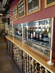 A wall of machines dispenses wines at GenuWine Arizona on Roosevelt Row at First Avenue and Roosevelt Street in downtown Phoenix.