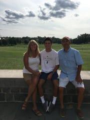 Eileen Valerio with son Eddie (center) and husband